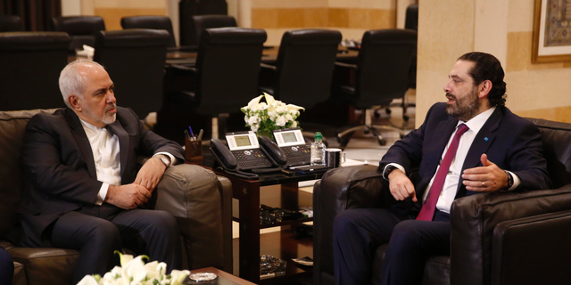 Lebanese Prime Minister Saad Hariri, right, meets with Iran's Foreign Minister Mohammad Javad Zarif, at the government palace, in Beirut, Lebanon, Monday, Feb. 11, 2019. Zarif extended an offer for Iranian military assistance to the U.S.-backed Lebanese army on Sunday, saying Iran is ready to assist in all sectors should the Lebanese government want it. (AP Photo/Hussein Malla)