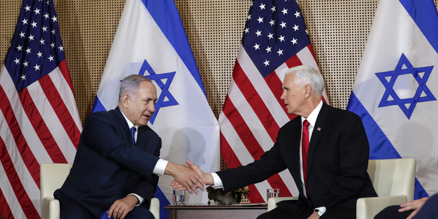 United States Vice President Mike Pence, right, shakes hands with Israeli Prime Minister Benjamin Netanyahu at a bilateral meeting in Warsaw, Poland, Thursday, Feb. 14, 2019. The Polish capital is host for a two-day international conference on the Middle East, co-organized by Poland and the United States. (AP Photo/Michael Sohn)
