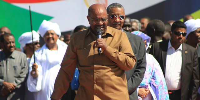 """FILE - In this Jan. 9, 2019 file photo, Sudan's President Omar al-Bashir addresses supporters at a rally in Khartoum, Sudan. On Tuesday, Feb 12, 2019, hundreds of demonstrators are gathering in different Sudanese cities, protesting against autocratic al-Bashir. The demonstrations, were called by the Sudanese Professionals Association, an umbrella of independent professional unions. Video footage shows demonstrators gathering at intersections chanting """"just fall,"""" and calling for a """"people's revolution."""" (AP Photo/Mahmoud Hjaj, File)"""