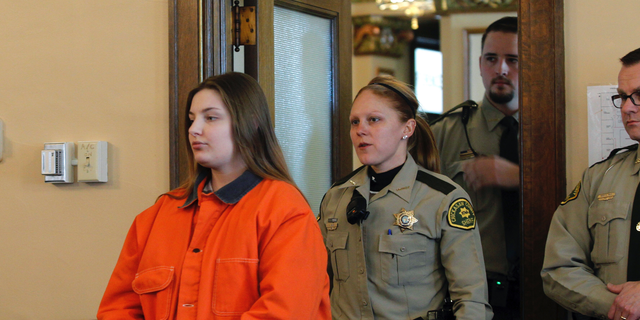 Cheyanne Renae Harris, left, enters the courtroom prior to sentencing Tuesday, Feb. 19, 2019, in New Hampton, Iowa. The Iowa woman whose infant son's lifeless body was found in a baby swing has been imprisoned for life without possibility of parole. Court records say Harris was sentenced to the state-mandated penalty, and her request for a new trial was denied. The charges stem from the death of 4-month-old Sterling Koehn, whose body was found Aug. 30, 2017, in a maggot-infested diaper at an apartment in Alta Vista. (Jeff Reinitz/The Courier via AP)
