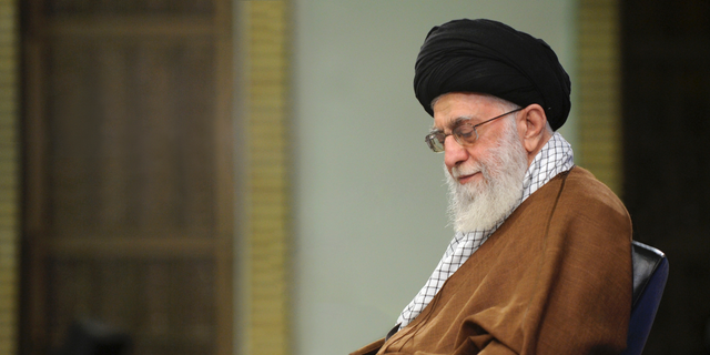 """In this picture released on Jan. 12, 2019, by the official website of the office of the Iranian supreme leader, Supreme Leader Ayatollah Ali Khamenei takes notes during a meeting in Tehran, Iran. In a statement released on Wednesday Feb. 13, Iran's supreme leader said negotiations with the U.S. """"will bring nothing but material and spiritual harm"""" — remarks that come ahead of an American-led meeting on the Mideast in Warsaw."""