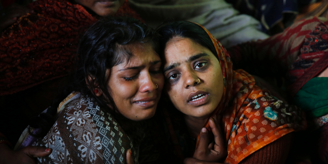 Sanju, right, and Sanjana, wife and sister respectively of paramilitary soldier Mahesh Yadav, who was killed in Thursday's explosion in Kashmir, mourn at their home in Tudihar, some 56 kilometers east of Prayagraj, Uttar Pradesh state, India, Saturday, Feb. 16, 2019. The death toll from a car bombing on a paramilitary convoy in Indian-controlled Kashmir has climbed to at least 40, becoming the single deadliest attack in the divided region's volatile history, security officials said Friday. (AP Photo/ Rajesh Kumar Singh)