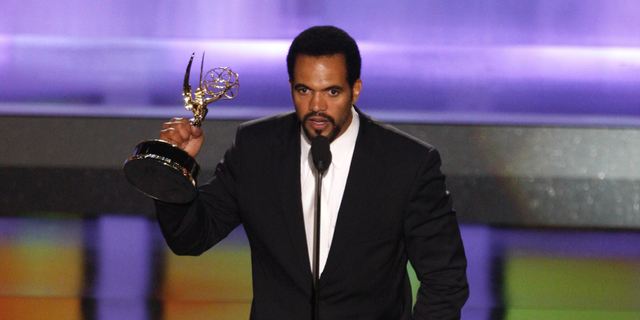 "In this June 20, 2008, file photo Kristoff St. John accepts the award for outstanding supporting actor in a drama series for his work on ""The Young and the Restless"" at the 35th Annual Daytime Emmy Awards in Los Angeles."