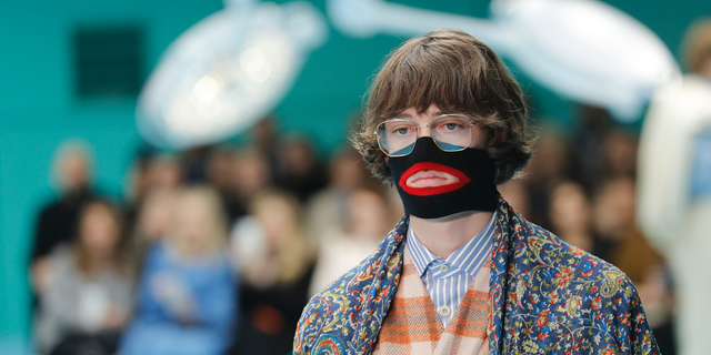 FILE - In this Feb. 21, 2018, file photo, a model wears a creation as part of the Gucci women's Fall/Winter 2018-2019 collection, presented during the Milan Fashion Week, in Milan, Italy. Gucci, which designed this face warmer, reminiscent of blackface prompted an instant backlash from the public and forced the company to apologize publicly on Wednesday, Feb. 6, 2019. (AP Photo/Antonio Calanni, File)