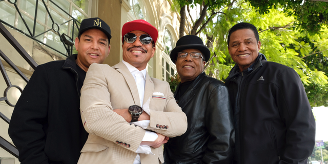 "In this Tuesday, Feb. 26, 2019, Marlon Jackson, second from left, Tito Jackson, second from right, and Jackie Jackson, far right, brothers of the late musical artist Michael Jackson, and Tito's son Taj, far left, pose together for a portrait outside the Four Seasons Hotel, in Los Angeles. Jackie, Tito, Marlon and Taj Jackson, gave the first family interviews Tuesday on ""Leaving Neverland,"" which features two Michael Jackson accusers and is set to air on HBO starting Sunday, March 3. (Photo by Chris Pizzello/Invision/AP)"