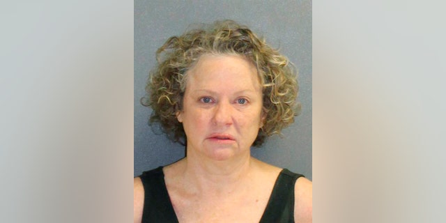 This Friday Feb. 8, 2019, booking photo made available by the Volusia County, Fla., Sheriff's Office, shows Julie Andrews, who was stopped by a deputy on suspicion of drunk driving. The deputy who is black said Andrews would have the Ku Klux Klan burn crosses on his property. The arrest report says Edwards smelled of alcohol, had slurred speech and was unsteady on her feet. (Volusia County Sheriff's Office via AP)