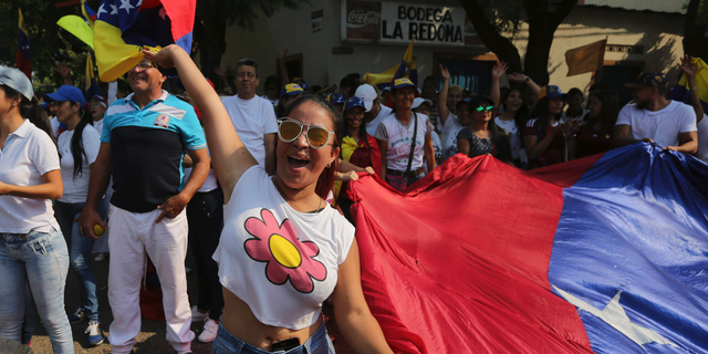 A woman shouts slogans against Venezuela's President Nicolas Maduro during a protest against his government in Urena, Venezuela, Tuesday, Feb. 12, 2019. Nearly three weeks after the Trump administration backed an all-out effort to force out President Nicolas Maduro, the embattled socialist leader is holding strong and defying predictions of an imminent demise. (AP Photo/Fernando Llano)
