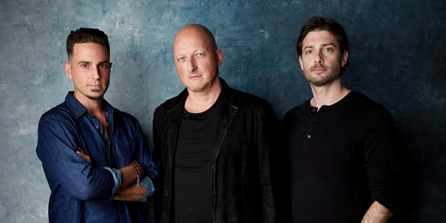 """FILE- In this Jan. 24, 2019, file photo Wade Robson, from left, director Dan Reed and James Safechuck pose for a portrait to promote the film """"Leaving Neverland"""" at the Salesforce Music Lodge during the Sundance Film Festival in Park City, Utah."""