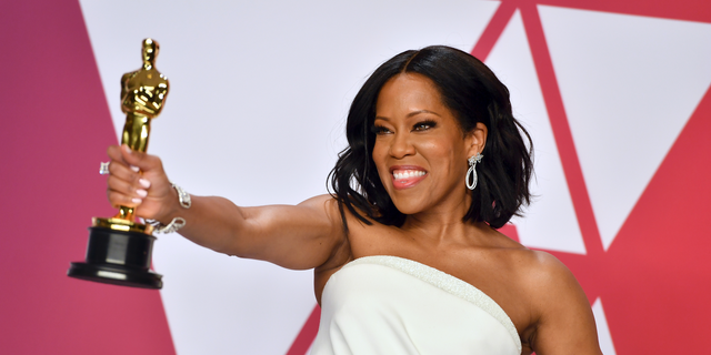 Regina King poses with the award for best performance by an actress in a supporting role for 'If Beale Street Could Talk' in the press room at the Oscars on Sunday, Feb. 24, 2019, at the Dolby Theatre in Los Angeles. (Photo by Jordan Strauss/Invision/AP, FILE)