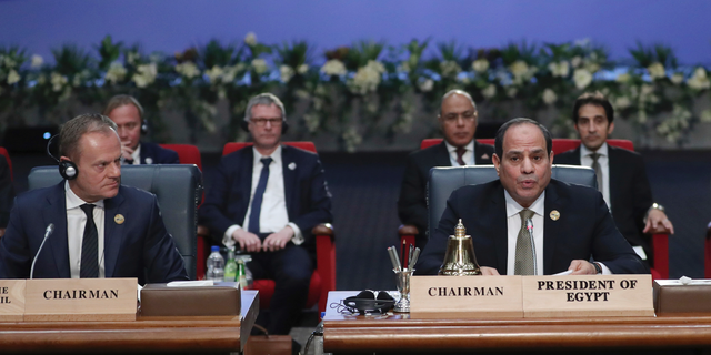 European Council President Donald Tusk, left, and Egypt's President Abdel-Fattah El-Sisi, right, attend a round table meeting at an EU-Arab summit at the Sharm El Sheikh convention center in Sharm El Sheikh, Egypt, Sunday, Feb. 24, 2019. Leaders from European Union and Arab League countries are holding their first-ever summit, meeting in the Egyptian resort city of Sharm el-Sheikh to discuss migration, security and business deals. (AP Photo/Francisco Seco)