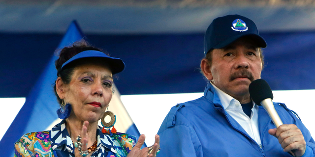 FILE - In this Sept. 5, 2018 file photo, Nicaragua's President Daniel Ortega and his wife, Vice President Rosario Murillo, lead a rally in Managua, Nicaragua. Despite the new Feb. 1, 2019 tax rises, Nicaragua has not seen a repeat of last year's mass protests. And it seems unlikely to, since Ortega forcefully quashed the challenge to his power, including effectively outlawing opposition demonstrations since September. (AP Photo/Alfredo Zuniga, File)