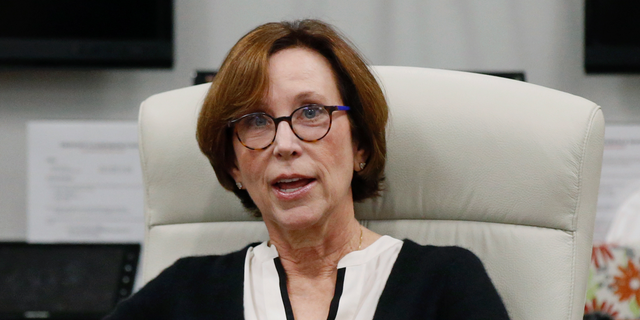 Chair of the University of Oklahoma Board of Regents, Dr. Leslie Rainbolt-Forbes announces that the Board of Regents will go into executive session during a special meeting in Oklahoma City, Wednesday, Feb. 20, 2019.  (AP Photo/Sue Ogrocki)