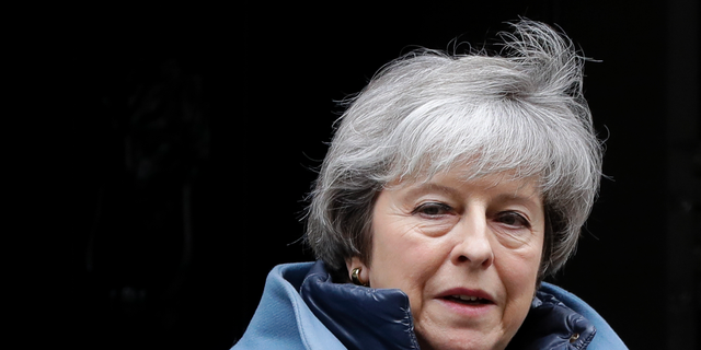 Britain's Prime Minister Theresa May leaves 10 Downing Street in London, Tuesday, Feb. 12, 2019. May is expected to address Parliament on Brexit later Tuesday, followed by a debate. (AP Photo/Kirsty Wigglesworth)