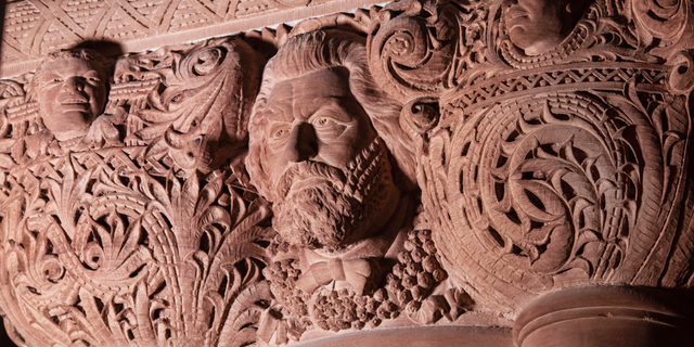 """This photo Wednesday, Feb. 27, 2019, provided by the New York Governor's Office shows the carved face and name of abolitionist Frederick Douglass in the New York state Capitol, in Albany, N.Y.  The Douglass face and name, believed to have been carved into a third-floor column into the ornate interior stonework of the """"Million Dollar Staircase"""" from 1884 to 1898, was corrected on Wednesday to add the second """"s"""" to his last name. (New York Governor's Office via AP)"""