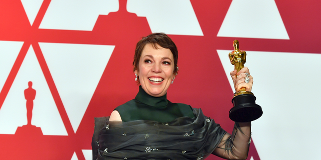 "Olivia Colman poses with the award for best performance by an actress in a leading role for ""The Favourite"" in the press room at the Oscars"