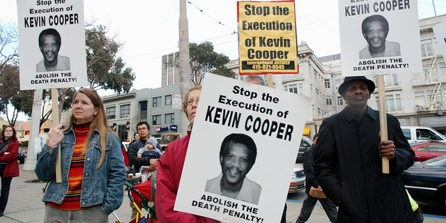 Protesters attend a rally in downtown San Francisco, Tuesday, Feb. 3, 2004, to denounce the Feb. 10 execution of Kevin Cooper at San Quentin State Penitentiary. Cooper was convicted of murdering two children and two adults in a Chino Hills home shortly after escaping from the California Institution for Men in nearby Chino in 1983.
