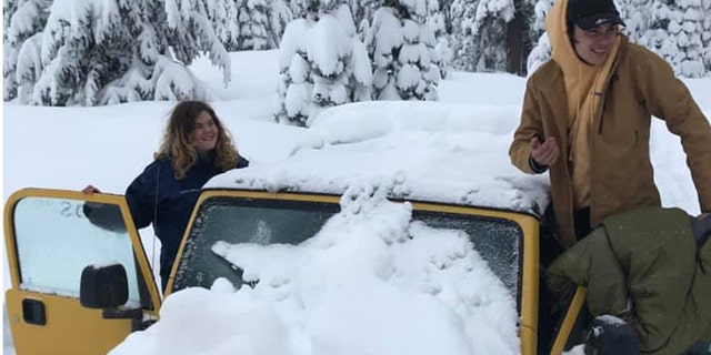 Carlos Hernandez-Isava and Maia Herman-Kitami were happy to be rescued after they were stranded in their Jeep for five days.