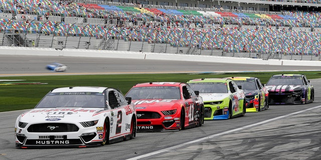 NASCAR drivers, from left, Brad Keselowski (2), Daniel Suarez (41), Tyler Reddick, William Byron and Jimmie Johnson wait on pit road for their turn on the track during auto racing practice for the Daytona 500 at Daytona International Speedway in Florida, Saturday. (AP Photo/John Raoux)