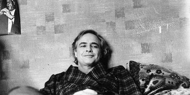 "American actor Marlon Brando relaxing on the set of ""The Last Tango in Paris."""