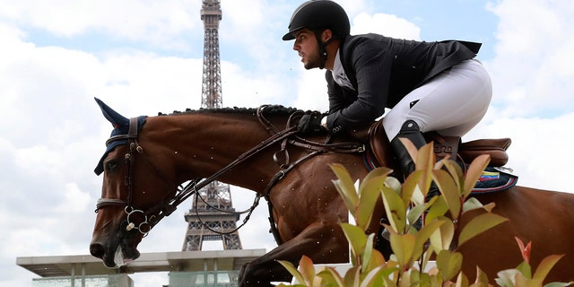 Venezuela's Emanuel Andrade riding Reus de la Nutria competes during the Paris Eiffel Jumping event on July 2, 2017 in Paris.