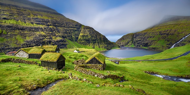 The Faroe Islands, inhabited by about 50,000 people and 80,000 sheep, draw visitors to their dramatic scenery, with waterfalls and abundant birdlife.