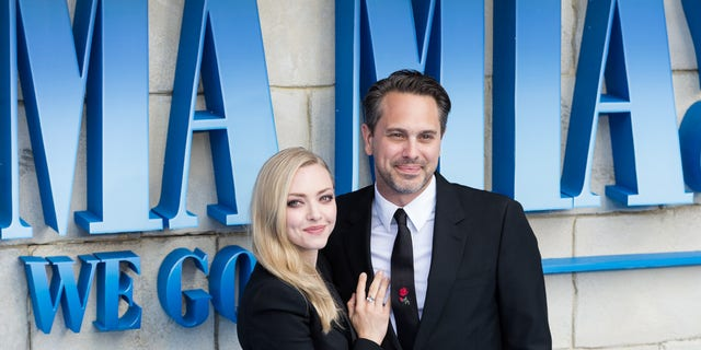 Amanda Seyfried and Thomas Sadoski arrive for the world premiere of 'Mamma Mia! Here We Go Again' at Eventim Apollo, Hammersmith in London on July 16, 2018.