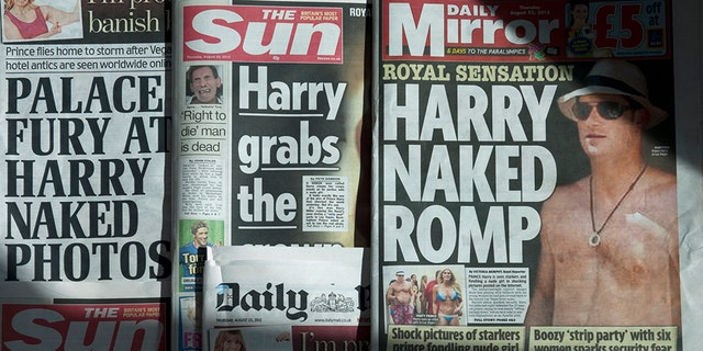 "An arrangement of British daily newspapers photographed in London on August 23, 2012 shows the front-page headlines and stories regarding nude pictures of Britain's Prince Harry. The British royal family on August 23 warned the country's newspapers not to publish nude photographs of Prince Harry cavorting with friends on holiday in Las Vegas. Newspapers on Thursday adhered to the palace's request with The Mirror having ""Harry naked romp"" splashed across its front page while the Daily Mail ran with ""Palace fury at Harry naked photos"" as its main headline."