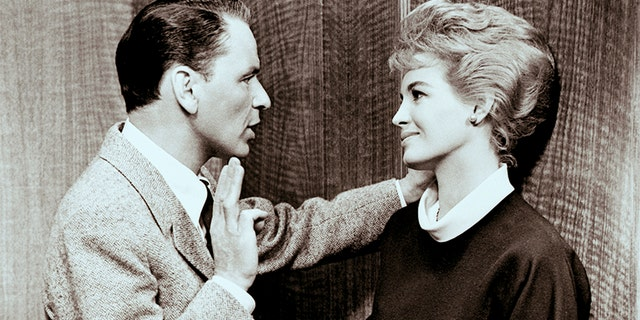 """Frank Sinatra and Angie Dickinson play husband and wife in """"Ocean's 11"""" a 1960 comedy about a plan to simultaneously rob five casinos in Las Vegas. — Getty"""