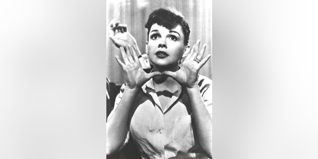 "Portrait of American popular singer and actress Judy Garland (1922 - 1969) as she makes the gesture later called ""Jazz Hands,"" in a still from the film ""A Star is Born,"" directed by George Cukor, circa 1954."