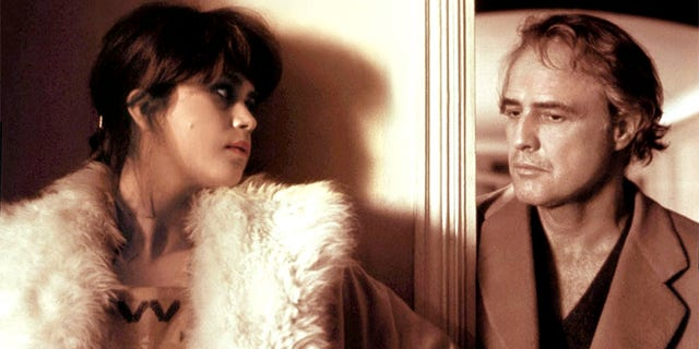 "French actress Maria Schneider and American actor Marlon Brando on the set of ""Last Tango in Paris"" written and directed by Italian Bernardo Bertolucci."