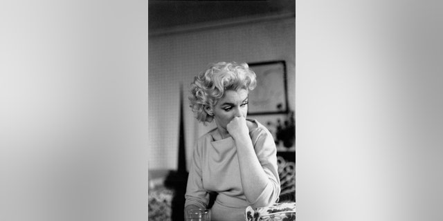 NEW YORK - MARCH 24: Actress Marilyn Monroe relaxes on a couch in her hotel room at the Ambassador Hotel on March 24, 1955 in New York City, New York.