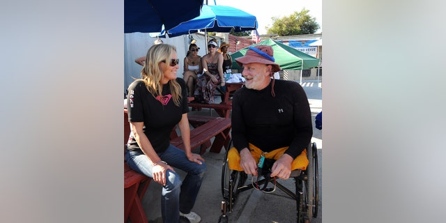 US actress Bo Derek (L) chats with US Army veteran Bill Johnson after a kayaking session during the 2nd National Veterans Summer Sports Clinic in San Diego, California on September 25, 2009.