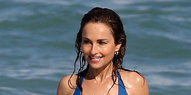 Famous chef Giada DeLaurentiis looks amazing in a revealing blue swimsuit as she hits the waves in Miami during the South Beach Wine & Food Festival. — MEGA
