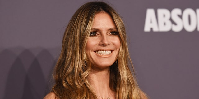 During lockdown, Heidi Klum has turned to hula-hooping and trampoline work to stay fit.