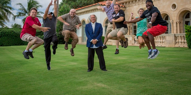 "Bob Massi in a light-hearted moment with the crew of ""The Property Man."""