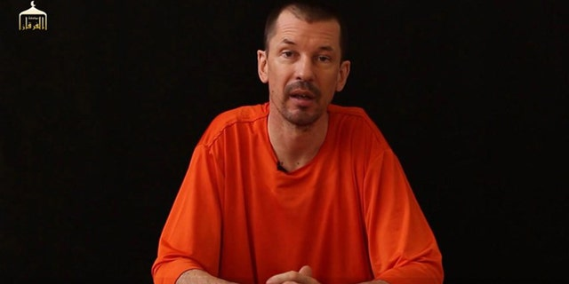 United Kingdom  security minister says hostage John Cantlie may still be alive