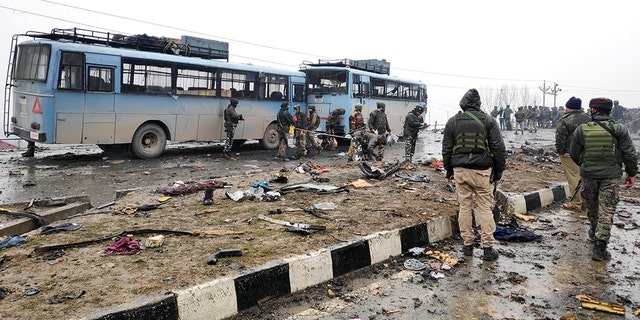 Pakistan-based groupJaish-e-Mohammad (JeM) claimed responsibility for a suicide bombing that killed more than 40 Indian soldiers in Kashmir on Feb. 14. The debris of the car bombing is pictured. (REUTERS/Younis Khaliq - RC1561C6D6E0)