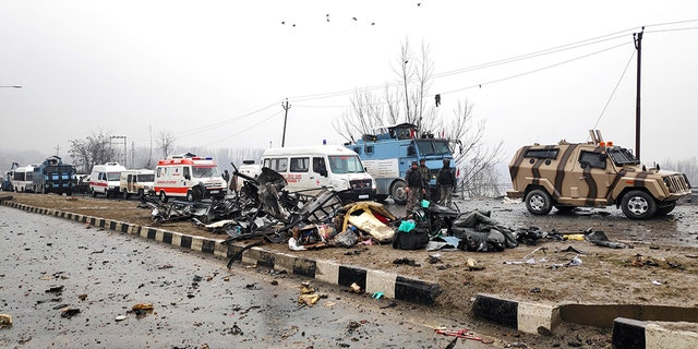 Indian soldiers examine the debris after an explosion in Lethpora in south Kashmir's Pulwama district.