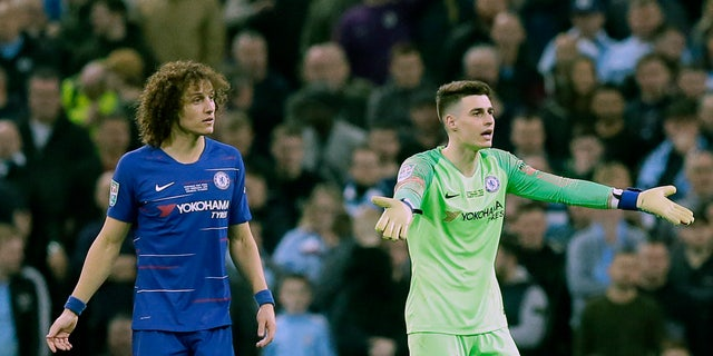 Chelsea goalkeeper Kepa Arrizabalaga, right, gesturing to the bench as captain David Luiz looked on during Sunday's League Cup final against Manchester City. (AP Photo/Tim Ireland)