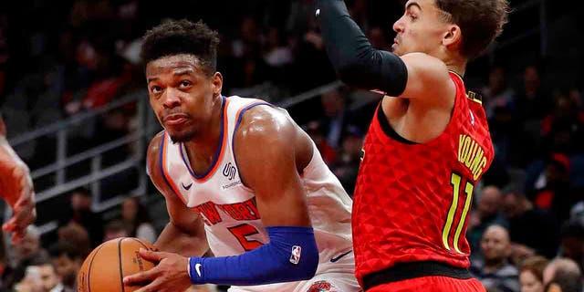 New York Knicks guard Dennis Smith Jr. (5) works against Atlanta Hawks guard Trae Young (11) during the second half of an NBA basketball game Thursday, Feb. 14, 2019, in Atlanta. New York won 106-91. (Associated Press)