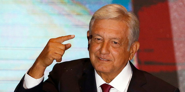 "President Andres Manuel Lopez Obrador has launched a campaign aimed at persuading people to not break the law. Its slogan is: ""We're all going to behave."" (AP Photo/Marco Ugarte)"