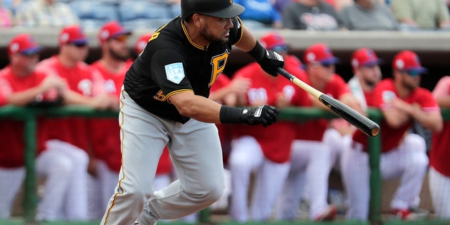 Pittsburgh Pirates' Melky Cabrera grounds out in the fourth inning with the runner Kevin Newman advancing to third in the fourth inning during a spring training baseball game against the Philadelphia Phillies, Saturday, Feb. 23, 2019, in Clearwater, Fla.
