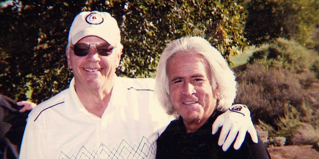 Bob Massi, right, poses with Fox News' Don Fair during a golf outing.