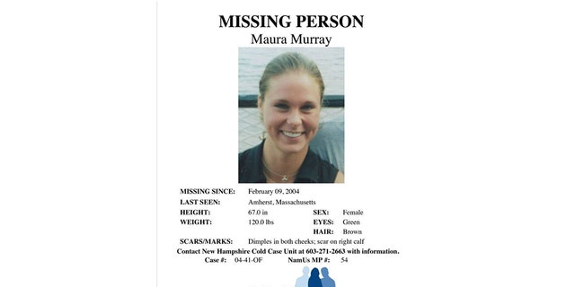 This Feb. 4, 2014 photo shows a missing person poster of Maura Murray that hangs in the lobby of the police station in Haverhill, N.H. It's been 15 years since Murray packed her car, lied to professors about a death in the family and left Massachusetts.