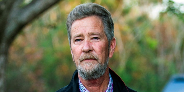 In this Dec. 5, 2018 file photo, Leslie McCrae Dowless Jr. poses outside his home in Bladenboro, N.C. Wake County District Attorney Lorrin Freeman said Wednesday, Feb. 27, 2019, that Dowless was arrested after grand jury indictments alleging illegal possession of absentee ballots and obstruction of justice. (Travis Long/The News & Observer via AP, File)