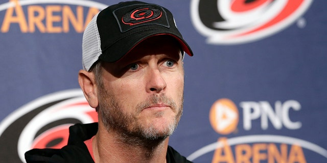 FILE - In this May 9, 2018, file photo, Carolina Hurricanes owner and CEO Tom Dundon takes questions during an NHL hockey news conference in Raleigh, N.C