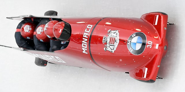 Driver Rudy Rinaldi, Boris Vain, Thibault Demarthon, and brakeman Mendonnaca Steven Borges of Monaco round a turn in the first run of the four-man Bobsled World Cup event, Saturday, Feb. 16, 2019, in Lake Placid, N.Y.