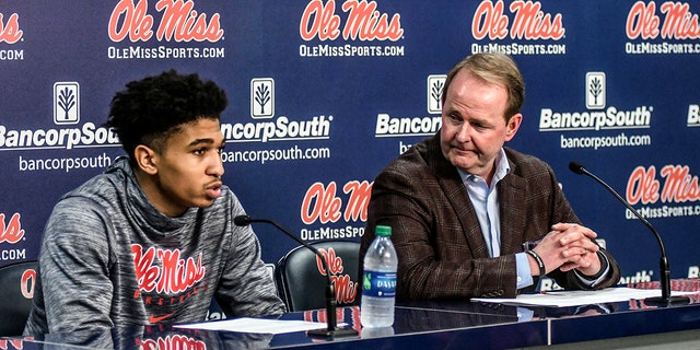 Mississippi guard Breein Tyree, left, speaks as head coach Kermit Davis listens during a post game news conference following an NCAA college basketball game against Georgia in Oxford, Miss., Saturday, Feb. 23, 2019. (Bruce Newman/The Oxford Eagle via AP)