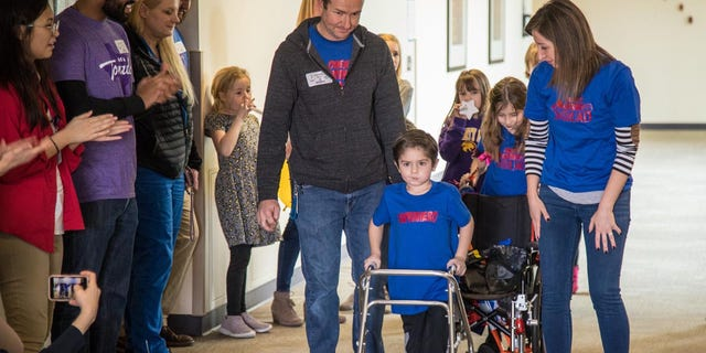 Owen Coulter, 5, uses a walker to help aid his rehabilitation as he makes a full recovery.