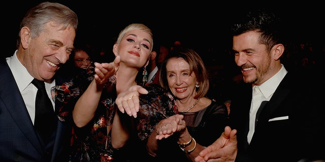 LR) Paul Pelosi, Katy Perry, Nancy Pelosi and Orlando Bloom Participate in MusiCares Person of the Year Honors Dolly Parton at the Los Angeles Convention Center on February 8, 2019 in Los Angeles, California.
